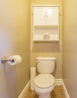 Bathroom with toilet and white cabinet