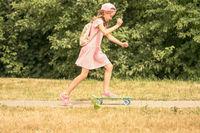 Child girl skateboarding in a park