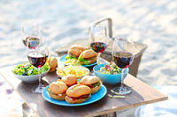 Picnic table with red wine glasses