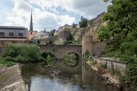 Alzette river Luxembourg city downtown Grund with fortifications and bridge