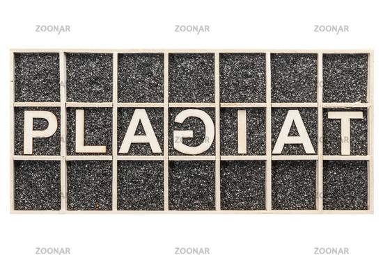 Word PLAGIAT unusual on black sand