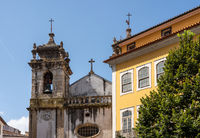 Crumbling bell tower of St Bartholomew church in Coimbra