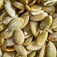 Macro photo of organic pumpkin seeds. Healthy food. Top view