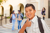 Young Male Hispanic Student Boy with Thumbs Up on Campus