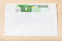 single one hundred euro note in envelope on table