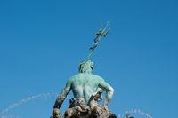 Backside of  male statue /  Neptune Fountain ( Neptunbrunnen)  in Berlin, Germany