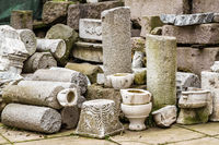 Ancient Marble Column Parts Stacked in a Museum Backyard