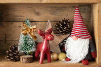 Christmas decoration deer figure and gnome in a wooden box background
