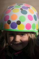Girl wearing cycle helmet outdoors