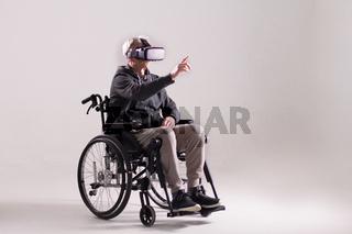 Disabled man wearing VR glasses.