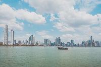 fisher boat with modern skyscraper city skyline background - Panama City -