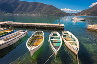 Three small fishing boats in a Kotor bay