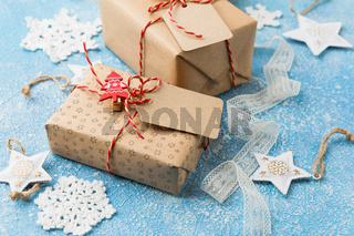 Gift box with stars and crocheted snowflakes