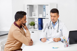 doctor showing prescription to patient at clinic