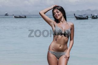 Woman on tropical beach in Thailand