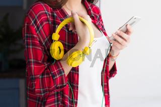 Girl with bright yellow headphones.