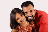 Father and daughter smiling looking at camera. Pune, Maharashtra