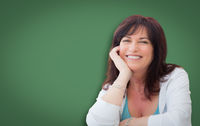 Attractive Middle Aged Woman Portrait In Front of Green Chalkboard