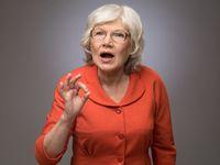 Senior lady showing ok sign