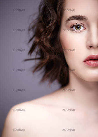 Closeup beauty portrait of young woman. Brunette girl with  day nude female makeup