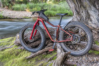 fat mountain bike on a river shore