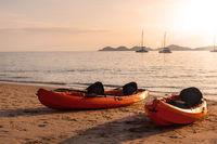 Kayaks on sandy beach