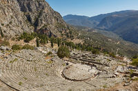 Delphi, Phocis / Greece. Ancient Theater of Delphi. The theater, with a total capacity of 5,000 spectators, is located at the sanctuary of Apollo. Panoramic view on a sunny day.