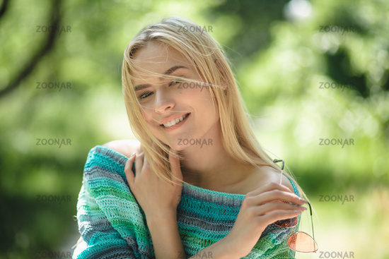 Beautiful blond girl in forest.
