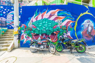 murals and motorcycles in thirteen district in Medellin