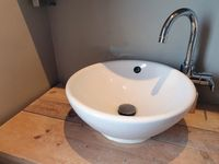 Stylish white sink, luxury white porcelain sink on wooden table bathroom