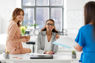 businesswomen at presentation in office