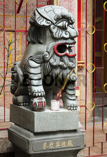 Chinese lion at the entrance of a temple