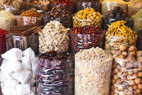 Spices and herbs being sold on street stall at arab traditional market
