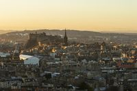 Edinburgh Castle skyline in golden light seen from Arthur's Seat