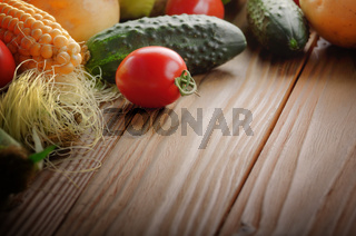 Fresh Organic Vegetable Food Ingredients on Wooden kitchen table background. Space for text.