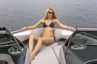 Beautiful Bikini Model Relaxing On A Boat