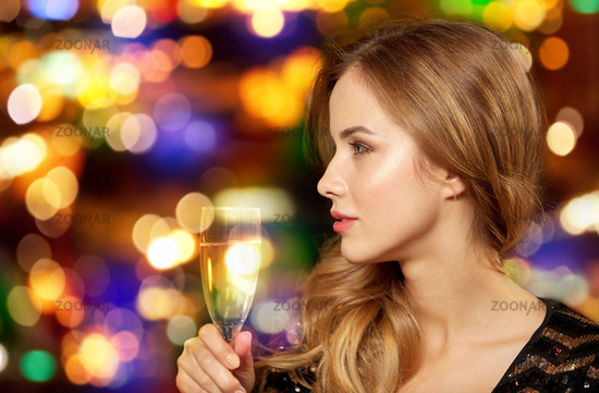 woman with glass of champagne at night club