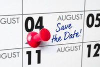 Wall calendar with a red pin - August 04