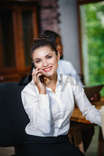 Young business woman in the office at the negotiations