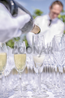Pouring champagne into glasses