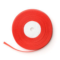 Top view of rolled red ribbon