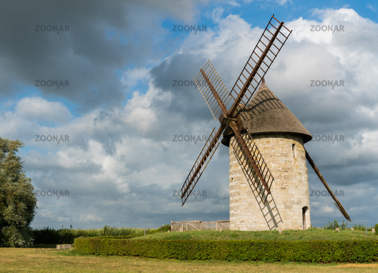 horizontal view of the historic windmill Moulin de Pierre in Hauville in Normandy