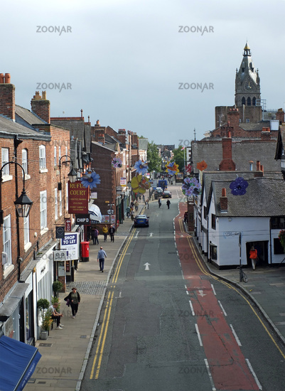 people walking along northgate street past pubs and shops in chester