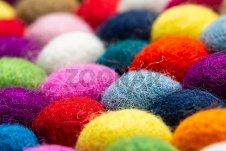 Multicolored felt ball rug detail