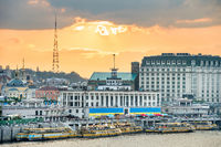 Kyiv skyline with embankment at sunset