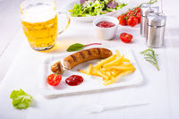 delicious bratwurst with rolls and beer