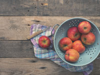 Organic apples in an old colander