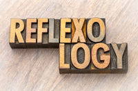 reflexology word abstract in wood type