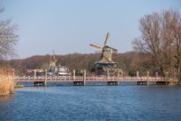 Windmill with lake and a bridge in Rotterdam