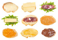 various open sandwiches on fresh bread isolated